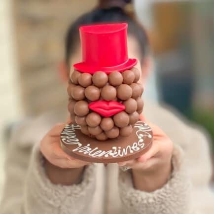 Malteser® Head with Red Hat & Lips