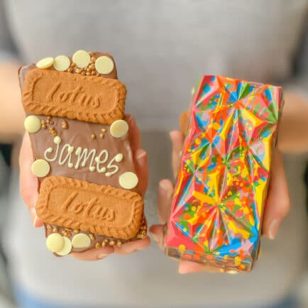 a front and a back view of an lgbtq+ pride-edition biscoff loaded choco bloc
