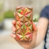 A red, green and yellow geometric shell on a reese's loaded choco bloc